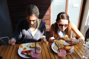 Going to town on our American breakfast feasts and smoothies.