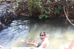 It looks like he is sitting in a mud puddle, but the minerals in the water made us float more in the springs.