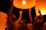 Keith and Zac letting go of their lantern.